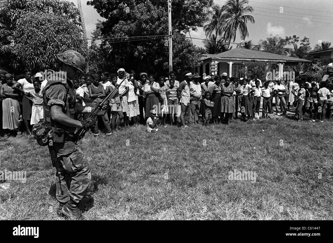 Marine guards civilians after his battalion landed on Grenada during the U.S. invasion. Oct 25-Nov 3 1983. (BSLOC - Stock Image