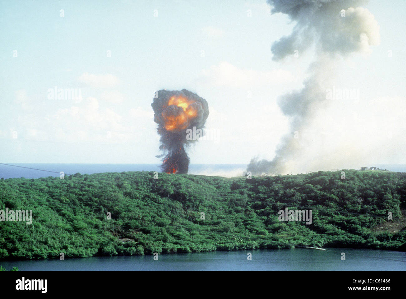 Explosion from a direct U.S. hit on a Grenadian position on the first day of the U.S. lead invasion of the Caribbean - Stock Image