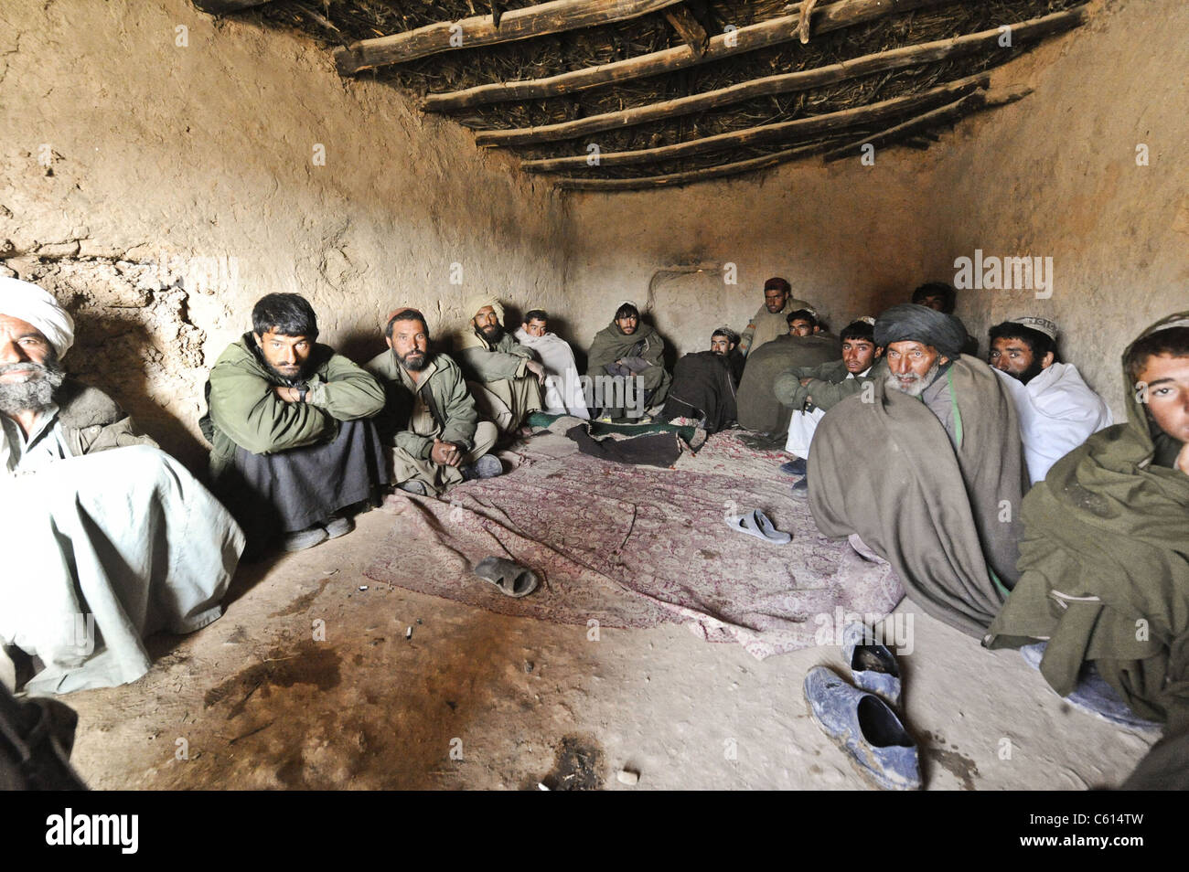 Suspected Taliban detainees held for questioning by Afghan National Army soldiers in Badula Qulp Helmand province - Stock Image