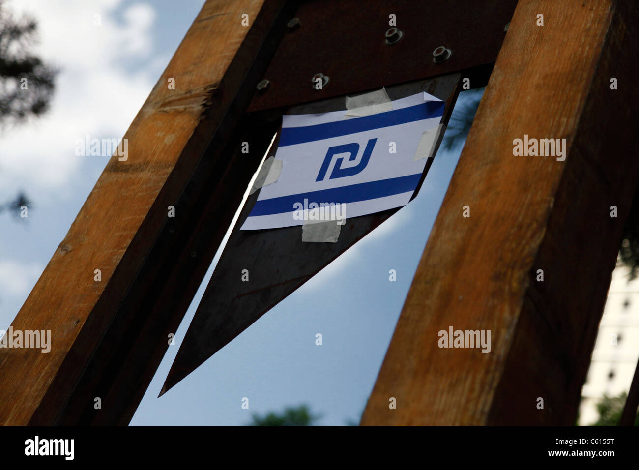Israeli Shekel Currency Symbol Attached To A Guillotine Installation