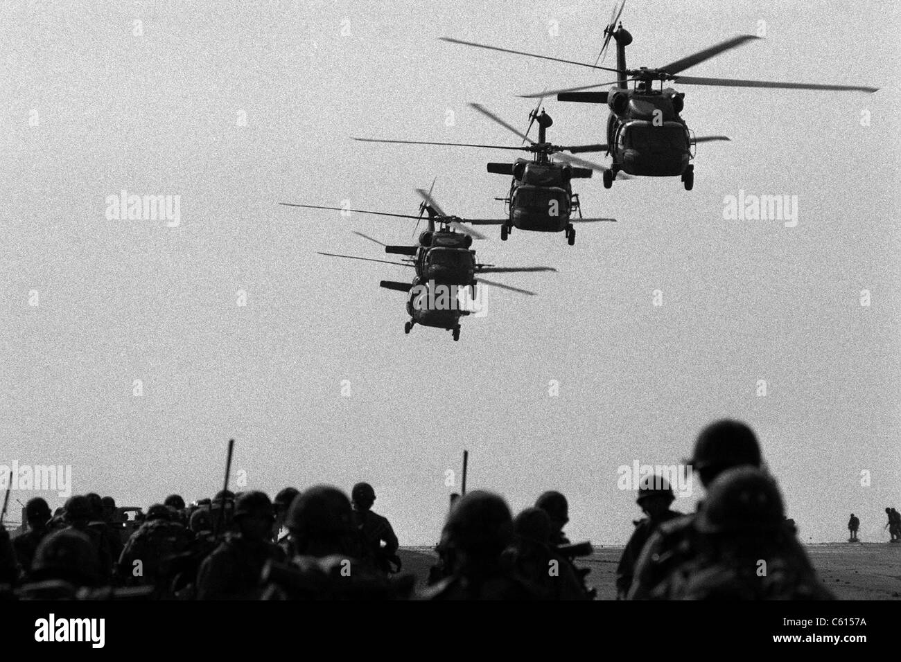 U.S. Army Black Hawk helicopters depart from Point Salines Airfield after bringing troops to the invasion of the - Stock Image