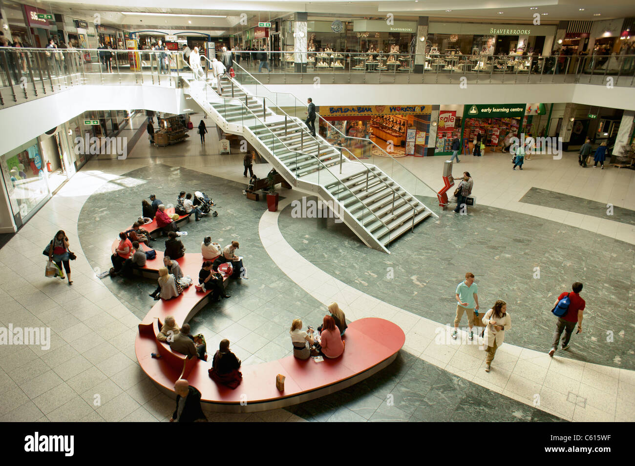 Arndale Centre, Manchester, England. Shoppers and retail outlet stores shops in the pedestrianised city centre shopping - Stock Image