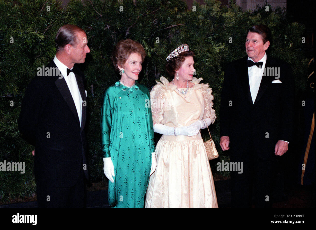 queen elizabeth ii and prince philip stand with president