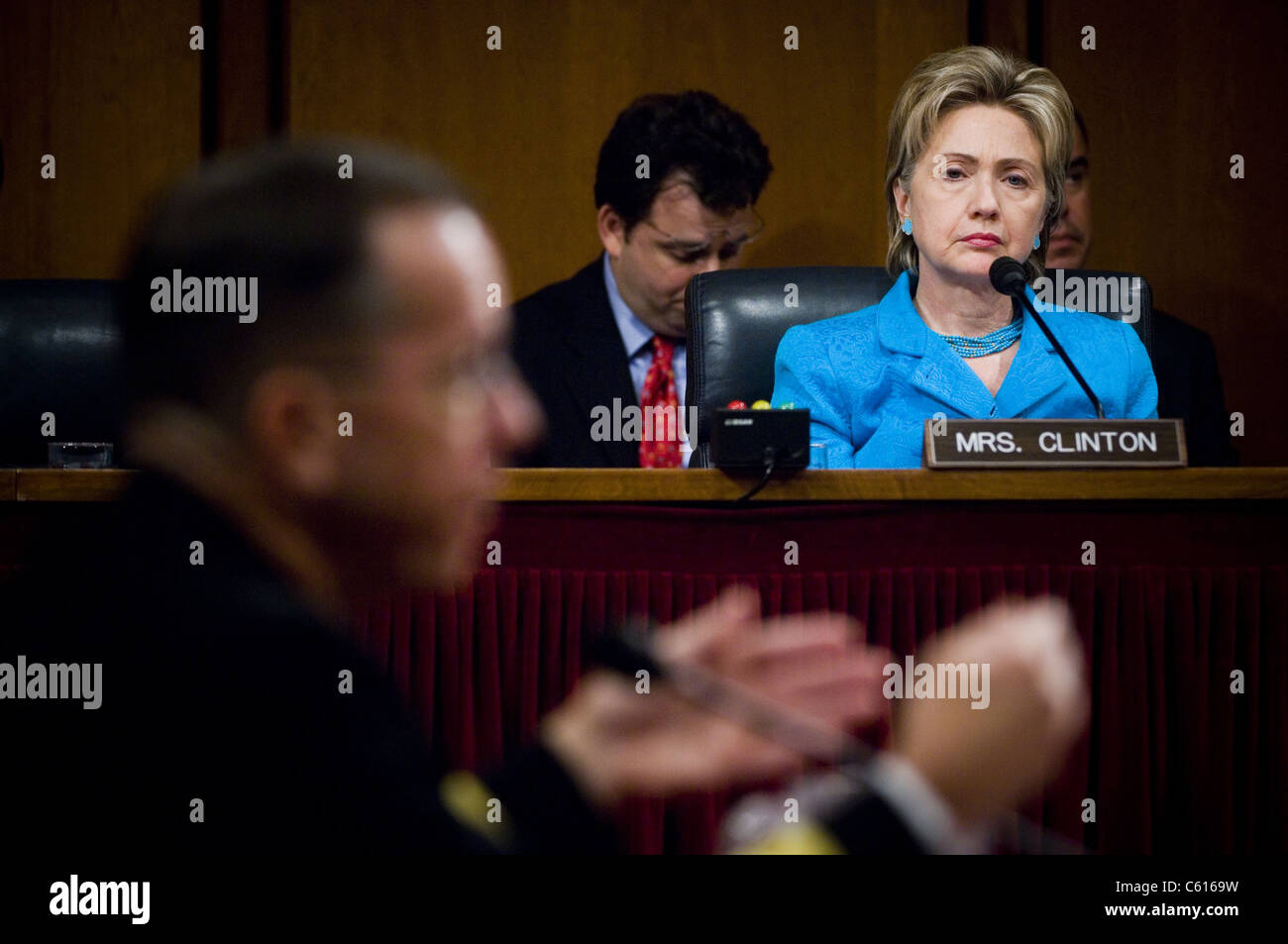 Senator Hillary Clinton a member of the Senate Armed Services Committee listens during the confirmation hearings - Stock Image