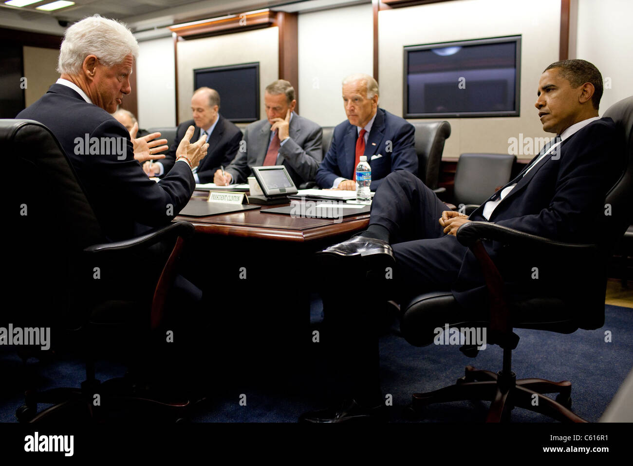 Former President Clinton briefs President Obama and National Security Advisors after his recent trip to North Korea. - Stock Image
