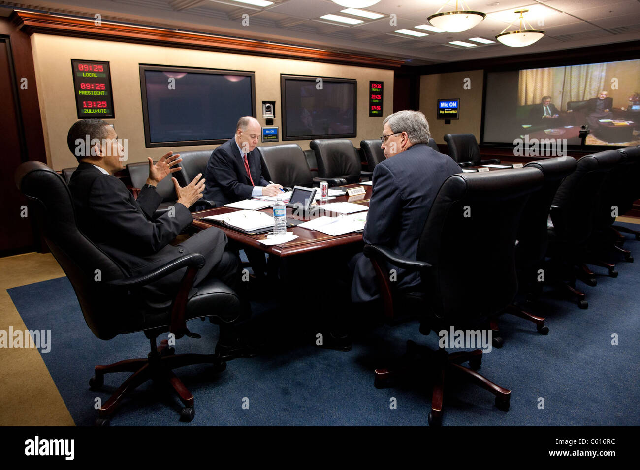 President Obama National Security Advisor Tom Donilon and Gen. Doug Lute hold a teleconference with President Hamid - Stock Image