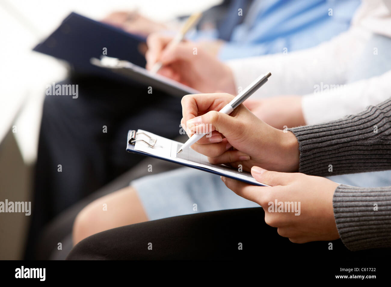 Close-up of human hands with pens over business documents - Stock Image