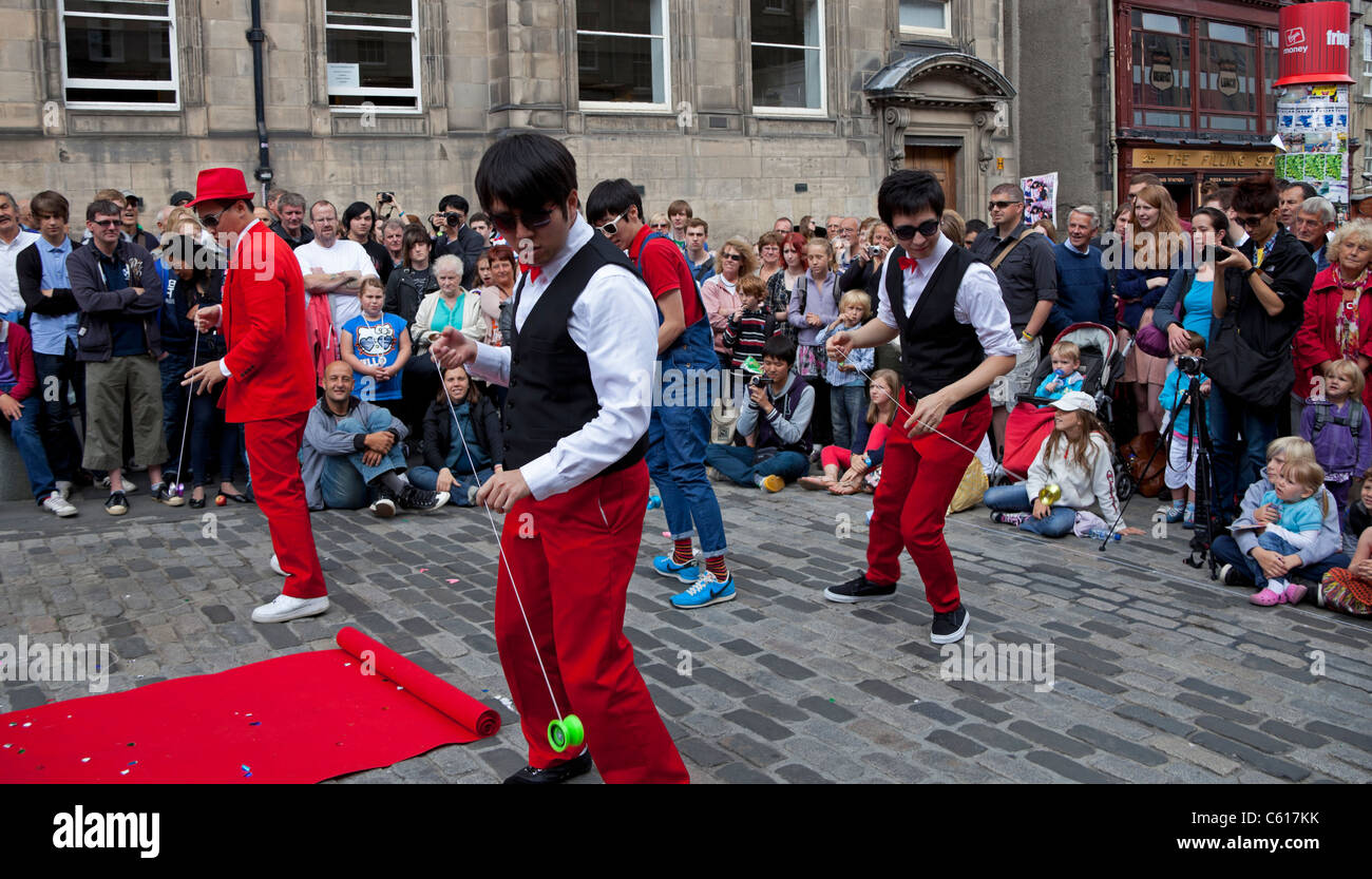 Edinburgh Fringe Festival South Korean street performers with yo yo Scotland UK Europe 2011 - Stock Image