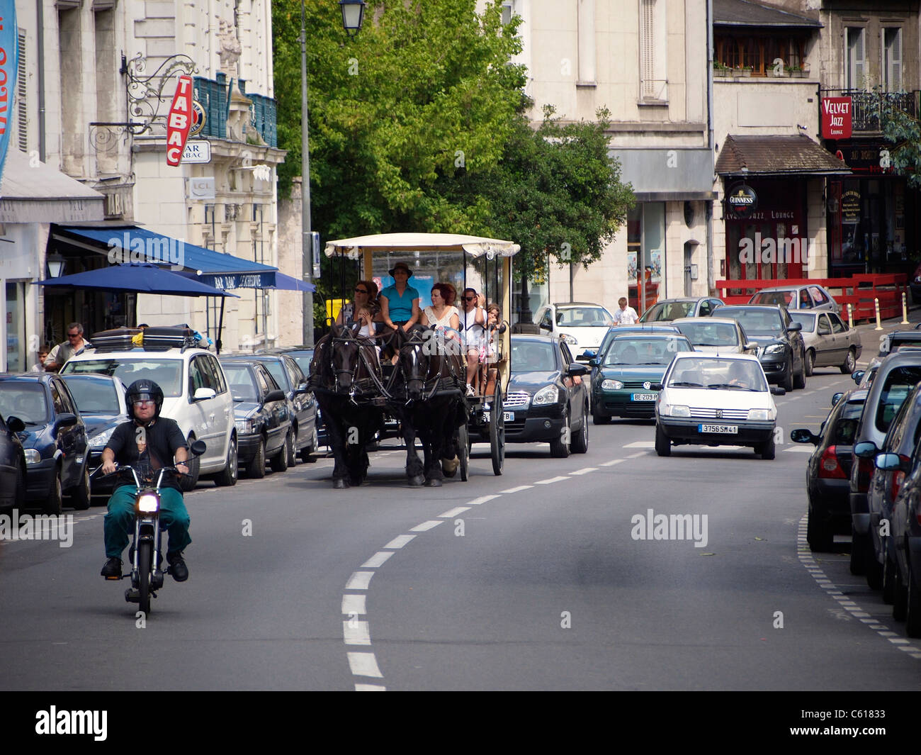 Horse and carriage carrying tourists through the streets of Blois, Loire valley, France - Stock Image