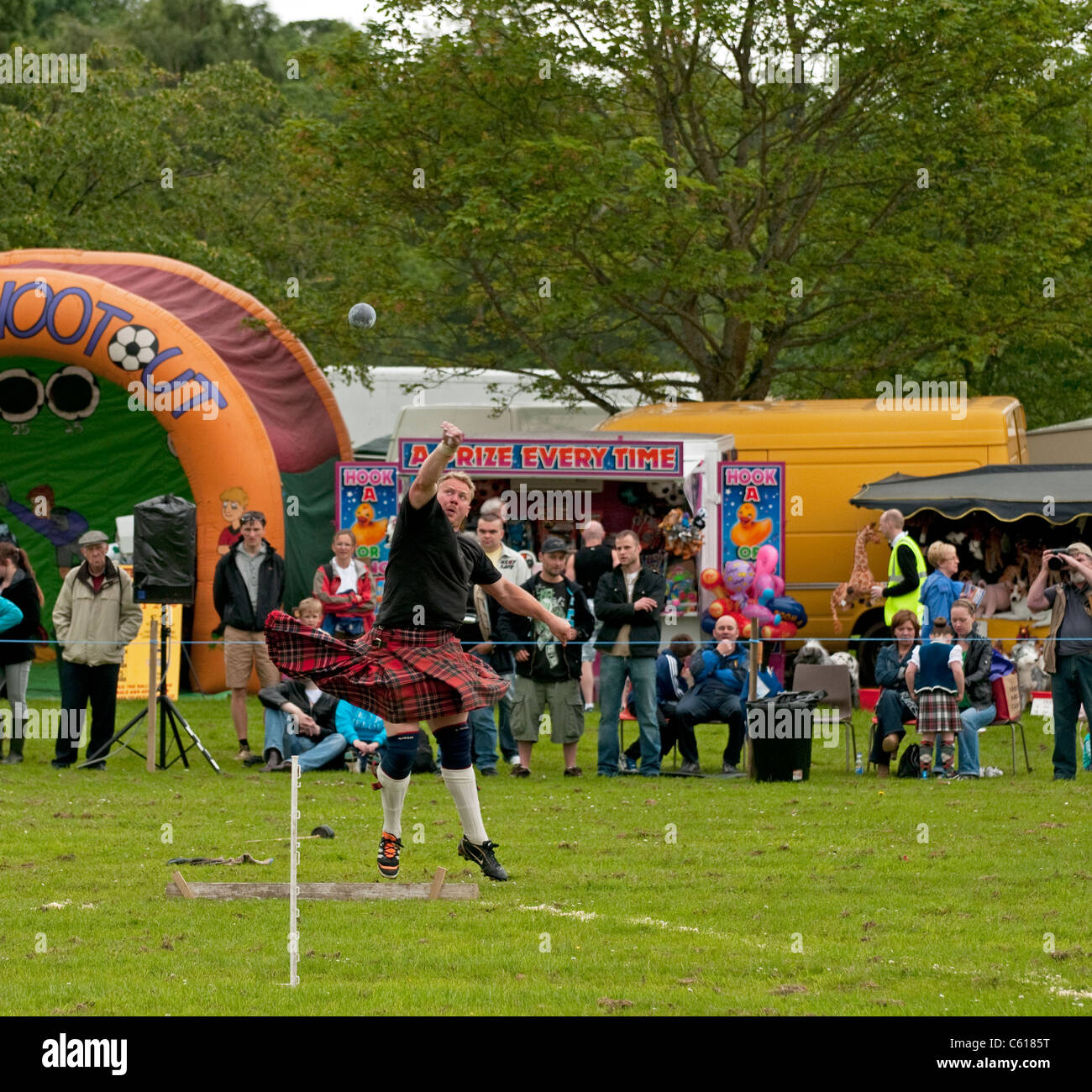 Shot Putt at Chatelherault Highland Games, Hamilton, Lanarkshire, Scotland, United Kingdom, Western Europe. - Stock Image