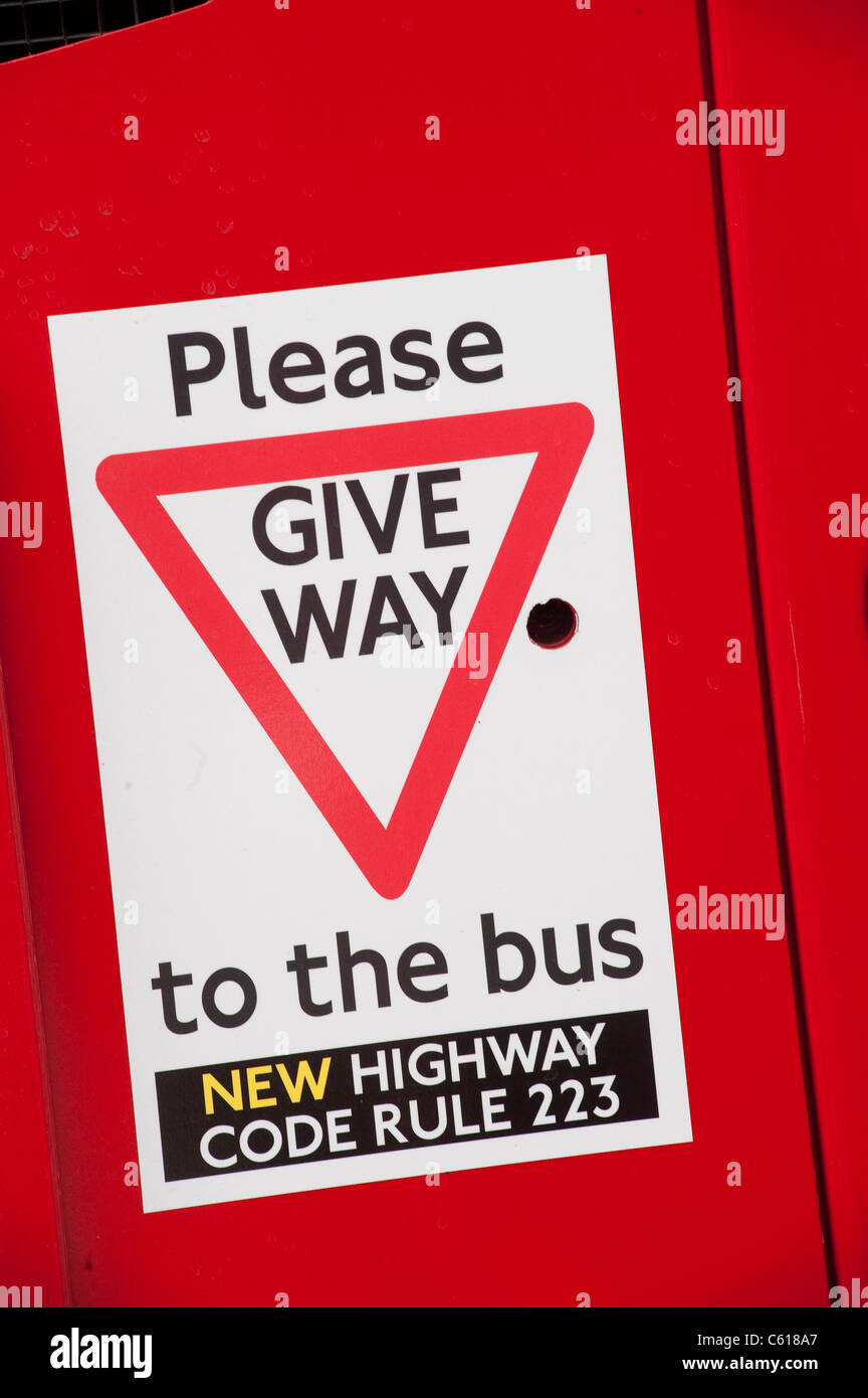 Sign on a bus warning other traffic to give way according to the new highway code rule 223 - Stock Image