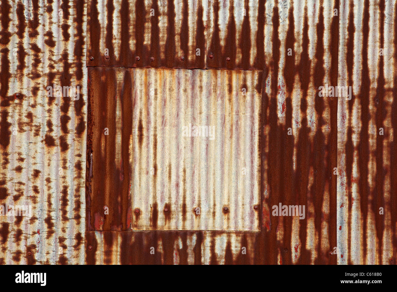 Rusty corrugated iron shed wall. New Zealand, Australasia - Stock Image