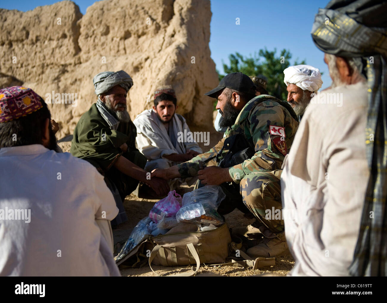 An Afghan commando medic assisted by U.S. Army Special Forces and Navy SEALs with Special Operations Task Force - Stock Image