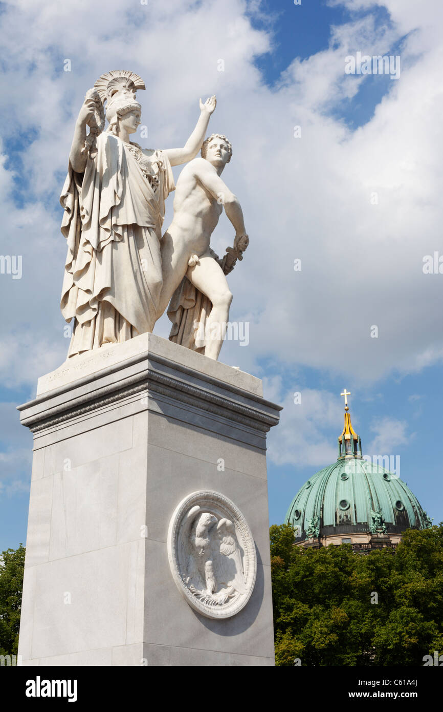 Classically themed sculpture on the Schlossbrucke in Berlin, Germany with Berlin Cathedral in the background. - Stock Image