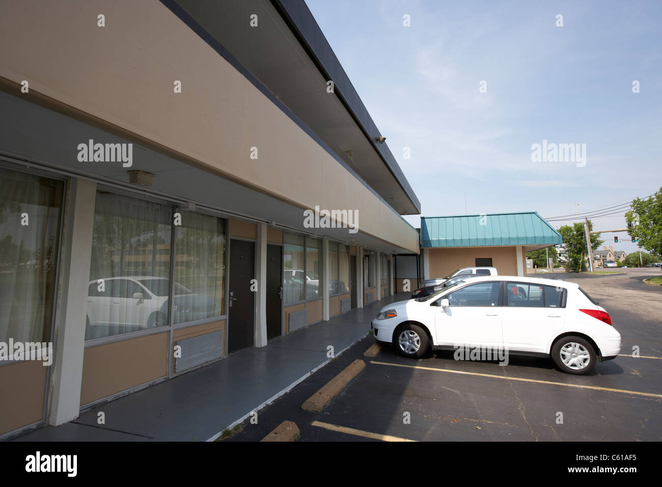 cars parked outside motel room block st louis county missouri usa - Stock Image