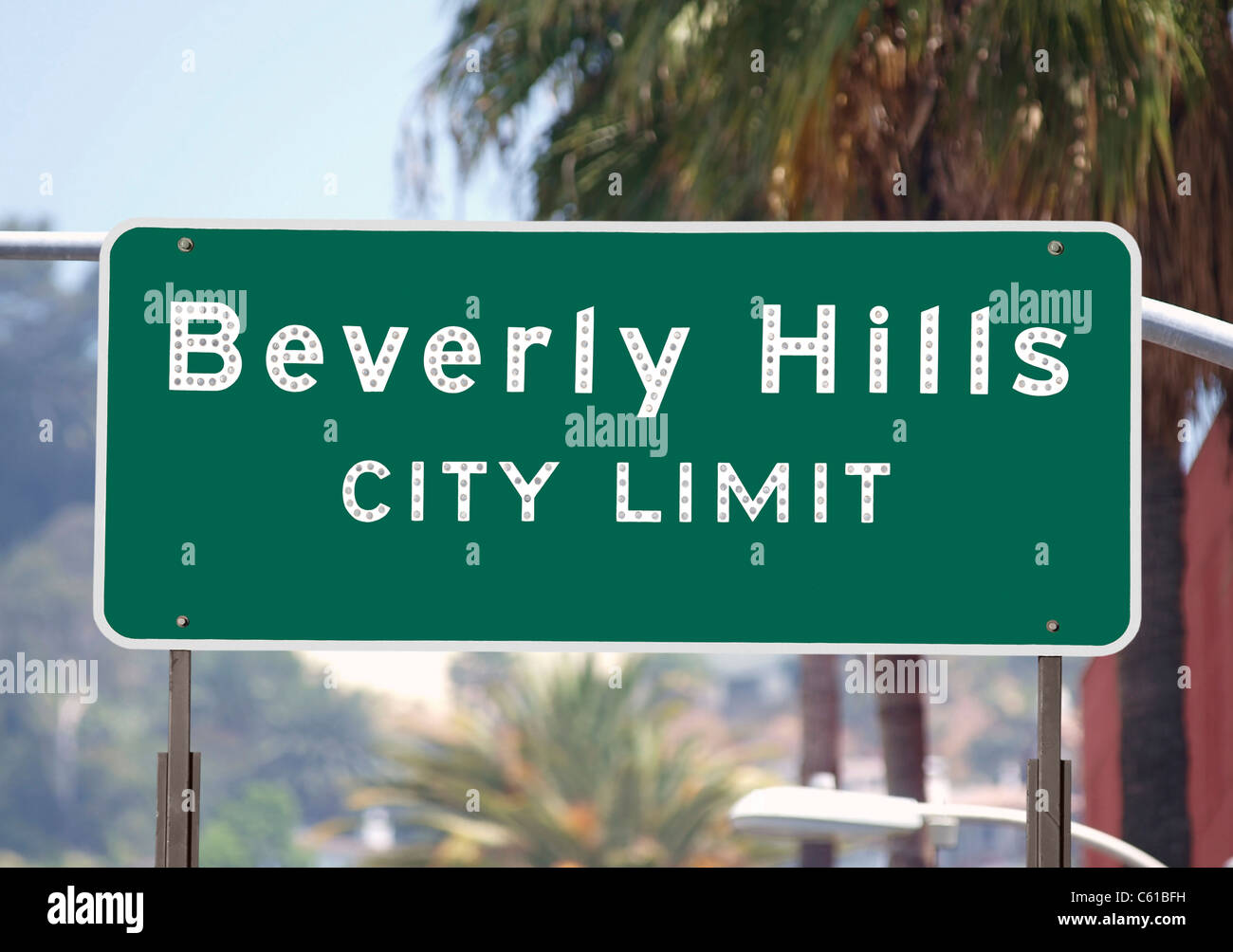 Beverly Hills city limits sign with palm trees. - Stock Image