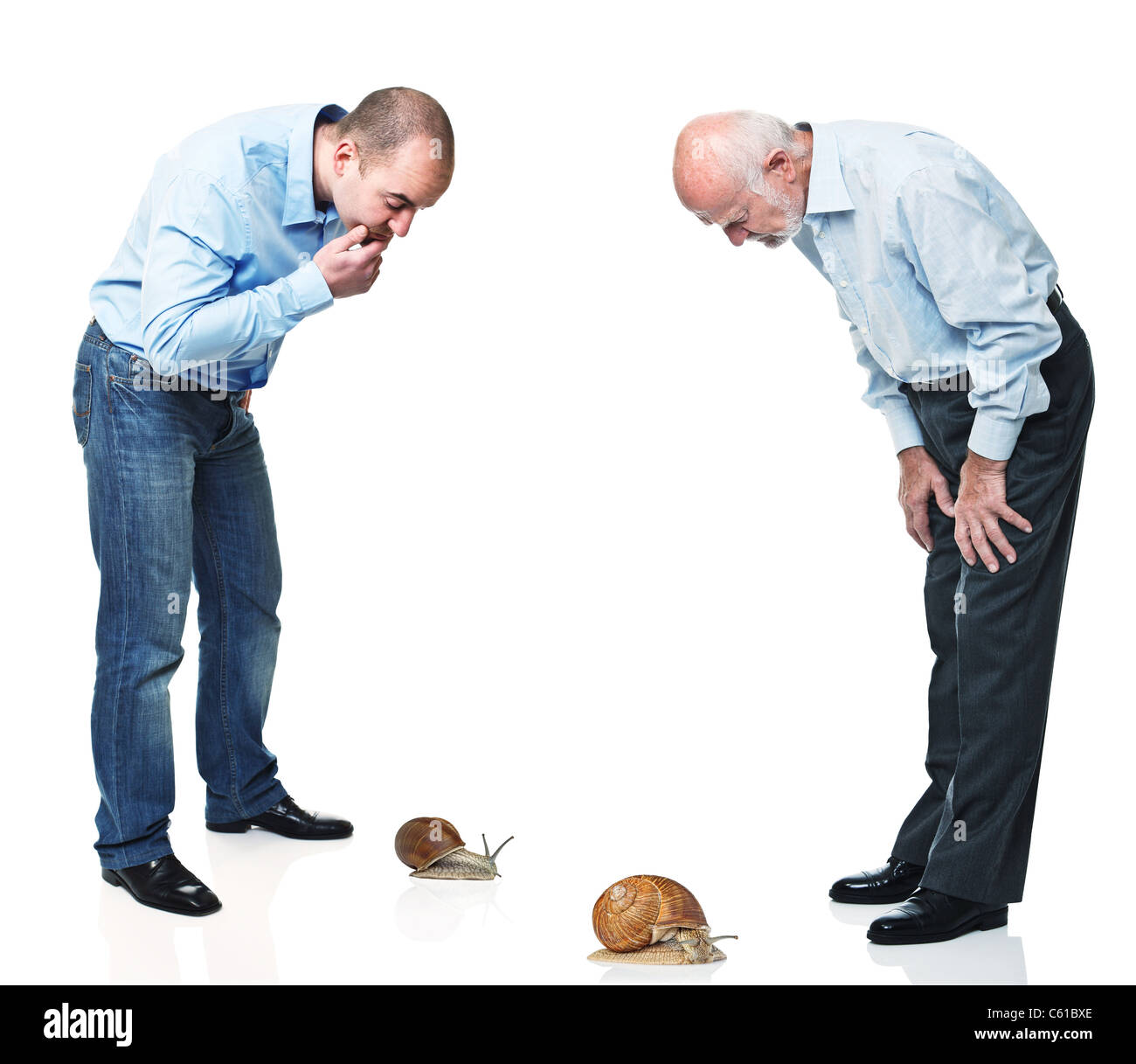 two man look at snail race - Stock Image