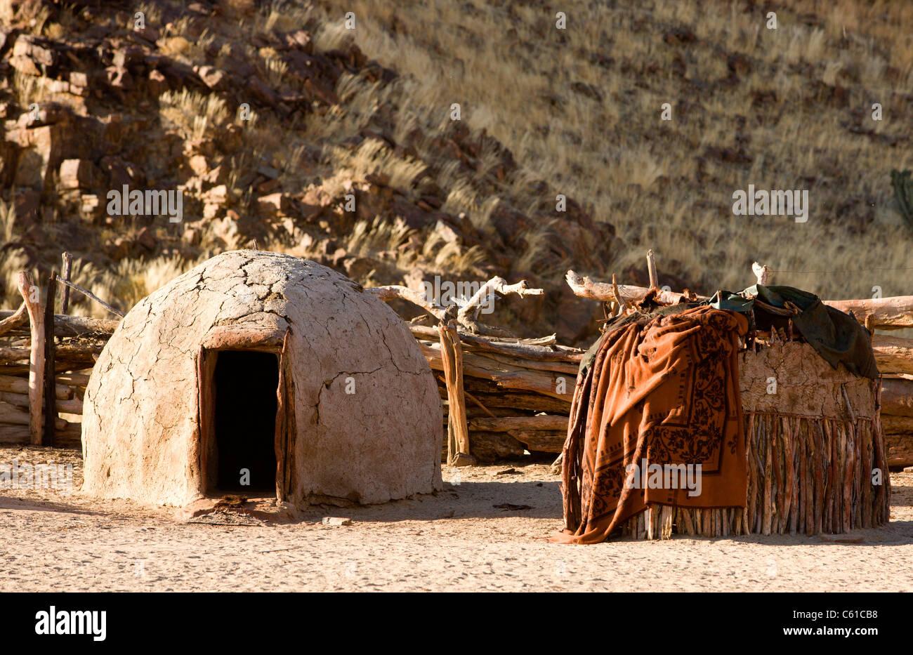 The traditional huts and dwellings of the Himba tribe. Purros, Northern Kaokoland, Kaokoveld, Namibia. - Stock Image