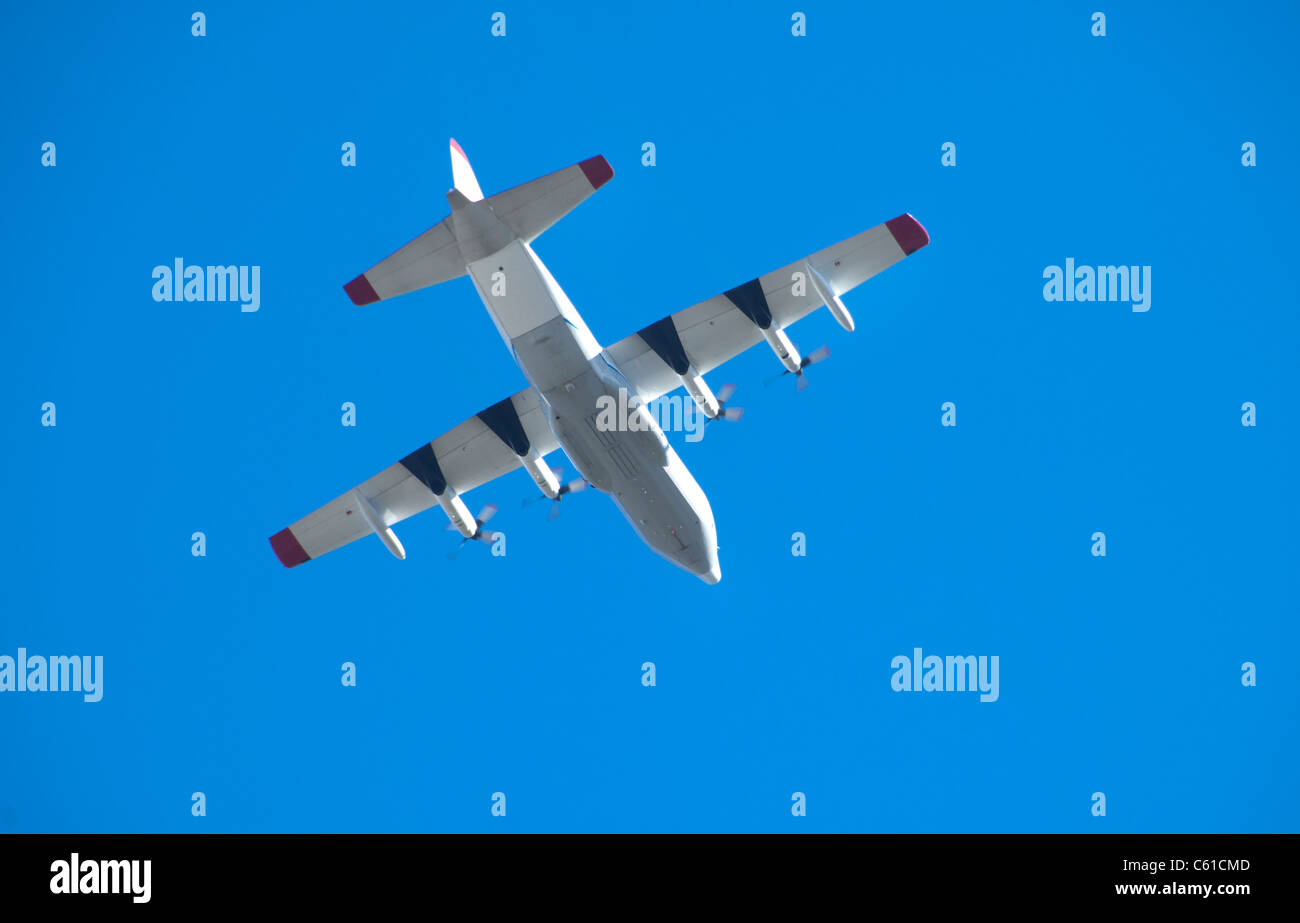A WC-130 flies over head. - Stock Image