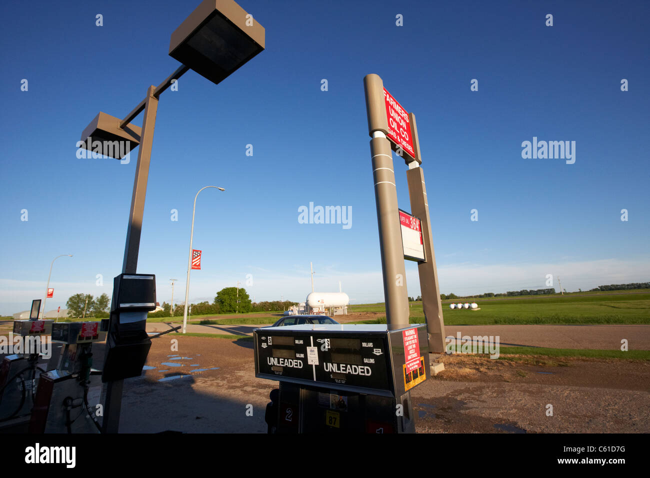 petrol pumps at farmers union oil company gas and diesel station in rural michigan north dakota usa - Stock Image