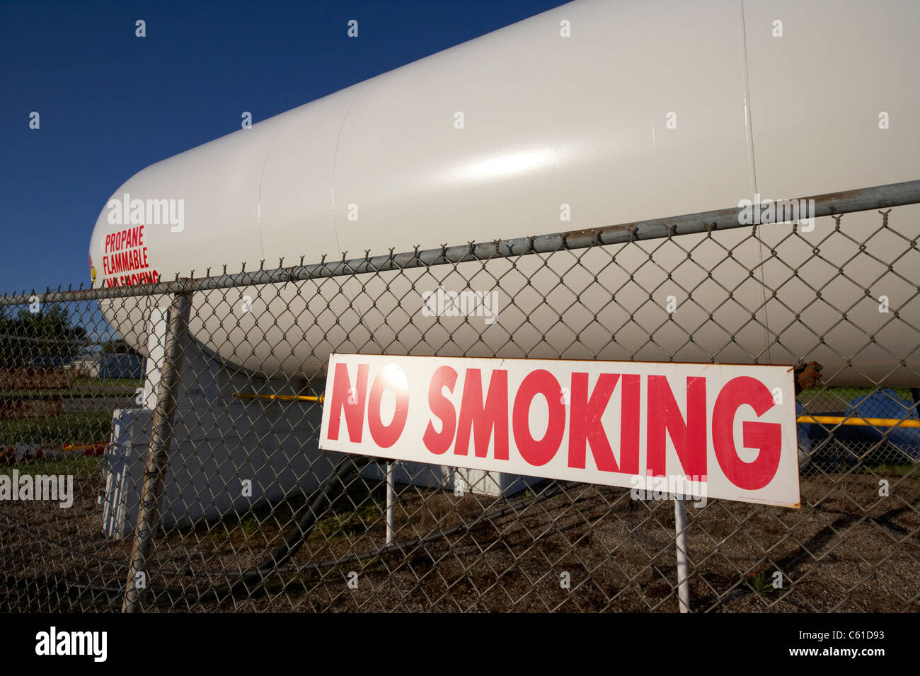 no smoking sign in front of propane gas fuel storage tank in michigan north dakota united states of america - Stock Image