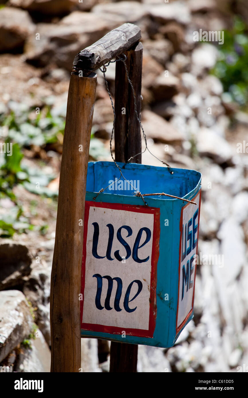 Encouraging litter bin seen on a trail in Bhutan. - Stock Image