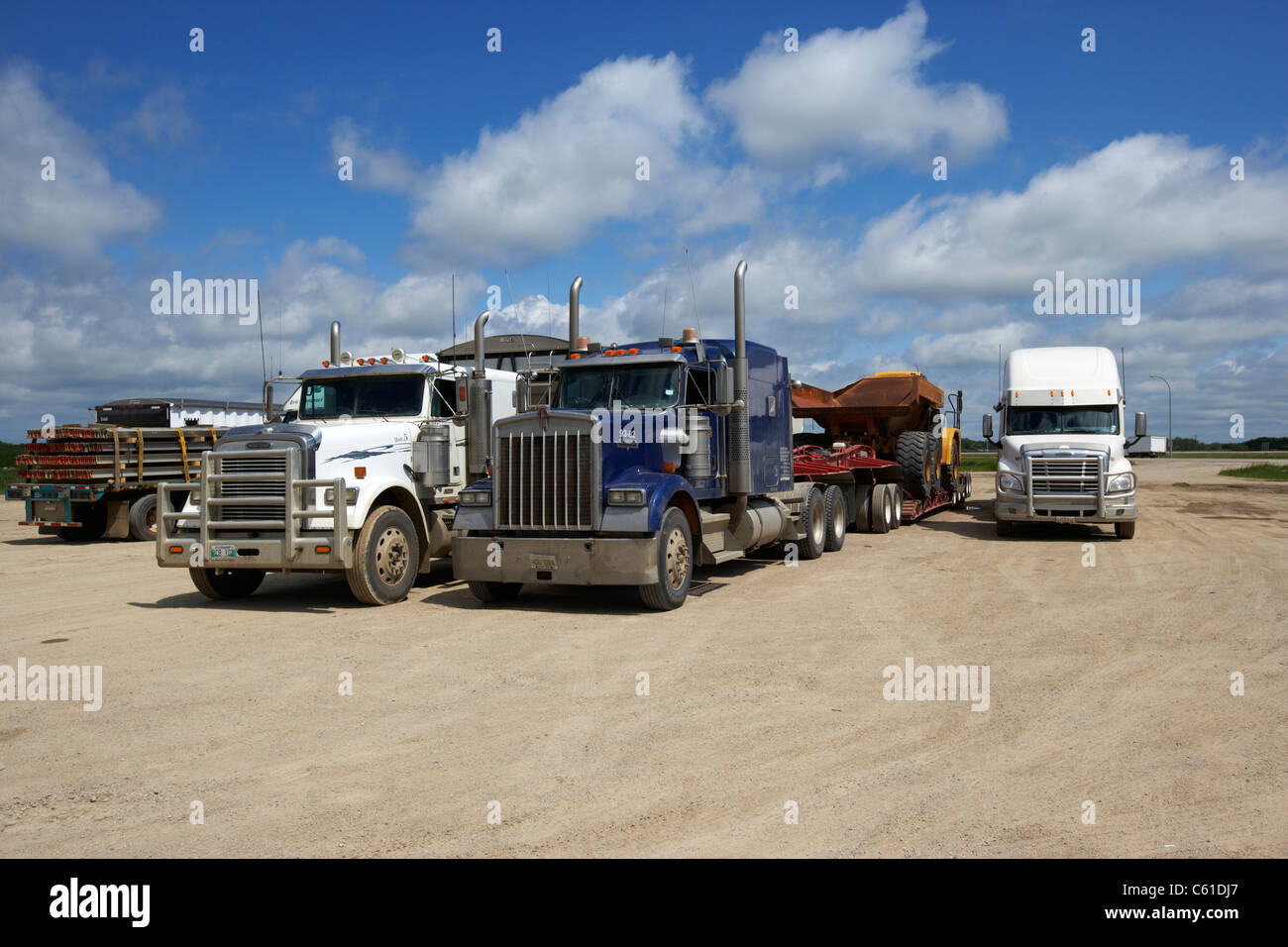 semi trucks parked at truck stop parking area in rural manitoba canada - Stock Image