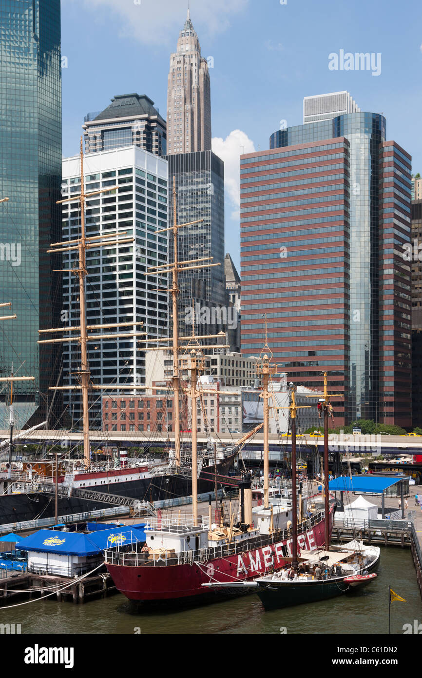 Ambrose light ship and other vintage ships docked at the South Street Seaport Museum in New York City. - Stock Image