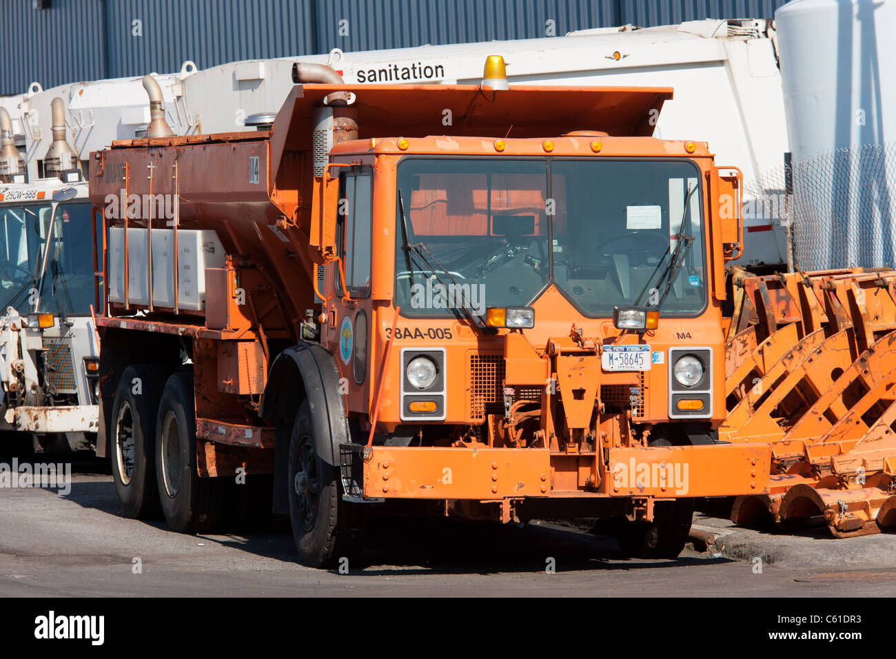 New York Department of Sanitation salt spreader, collection trucks and other equipment in the facility on Bloomfield - Stock Image