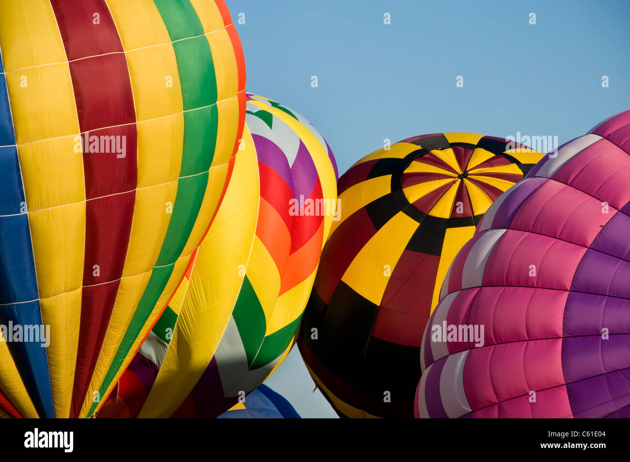 Several hot-air balloons being inflated Stock Photo