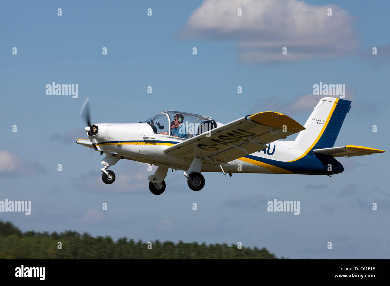 Morane Saulnier MS880B Rallye Club G-ASAU  in fliht taking-off - Stock Image