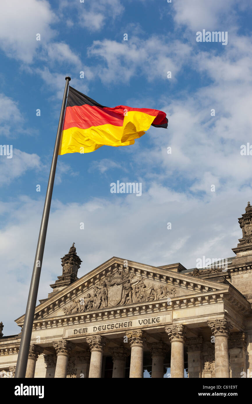The German flag flies outside the Reichstag in Berlin, Germany. - Stock Image