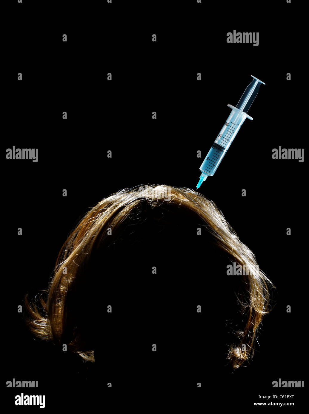 Human Head with Hypodermic Syringe - Stock Image