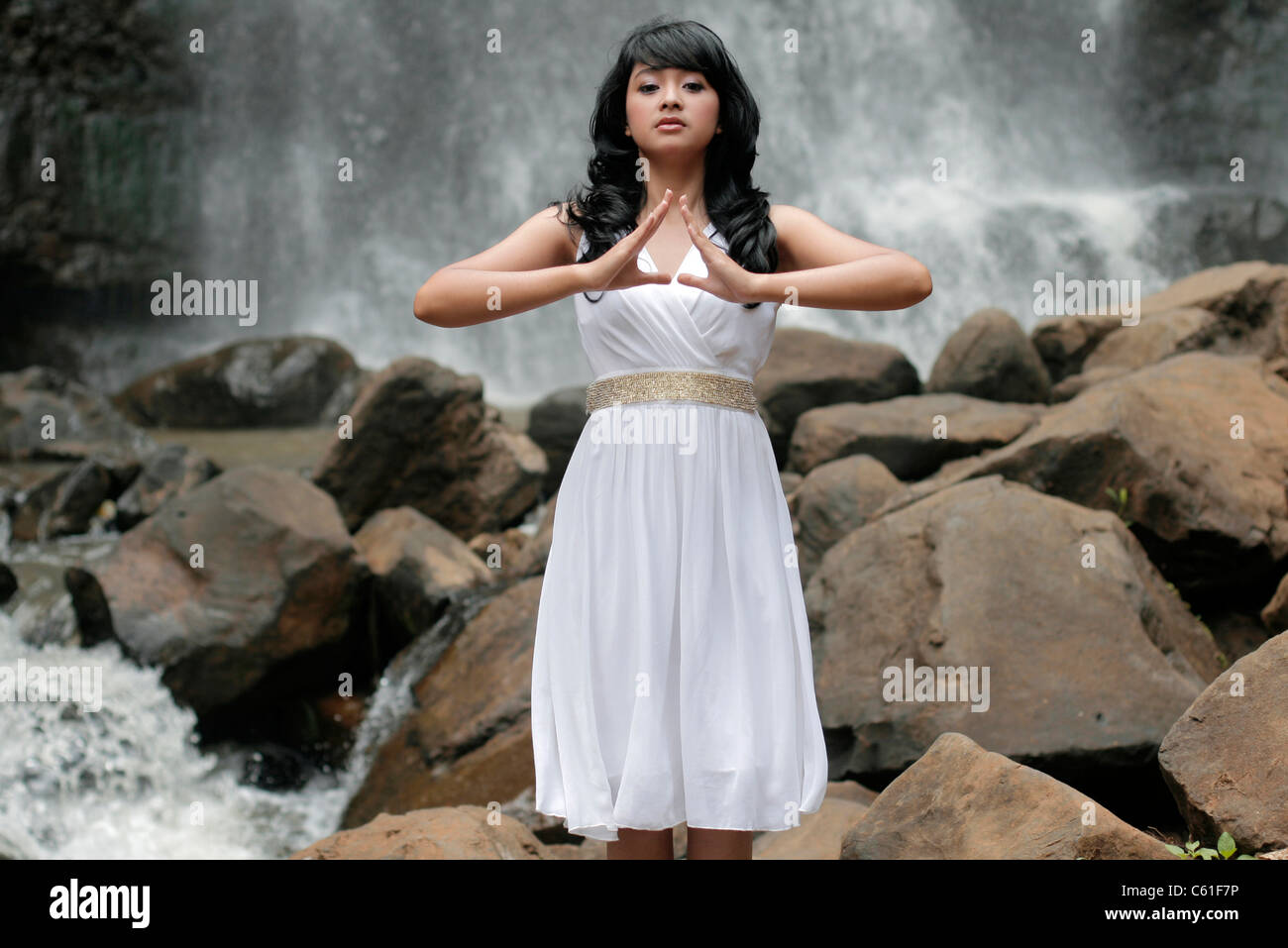 girl on waterfall landscape orientation - Stock Image