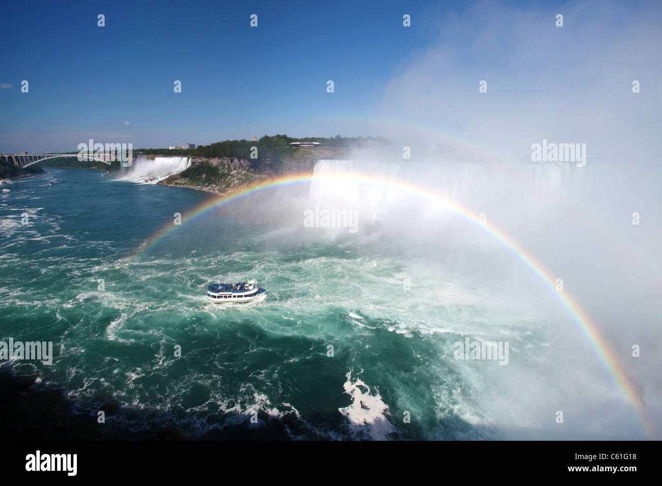 Maid-of-the-mist tour boat under double rainbow in Niagara falls, Ontario, Canada, 2011 - Stock Image