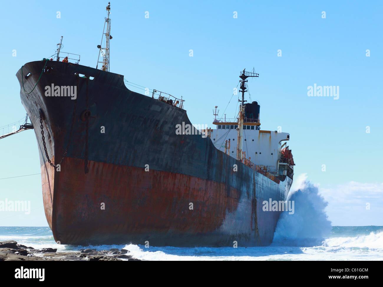 The 164 metre bulk tanker, Phoenix, aground on a rocky shelf at Christmas Bay, Sheffield Beach, KwaZulu Natal, South - Stock Image
