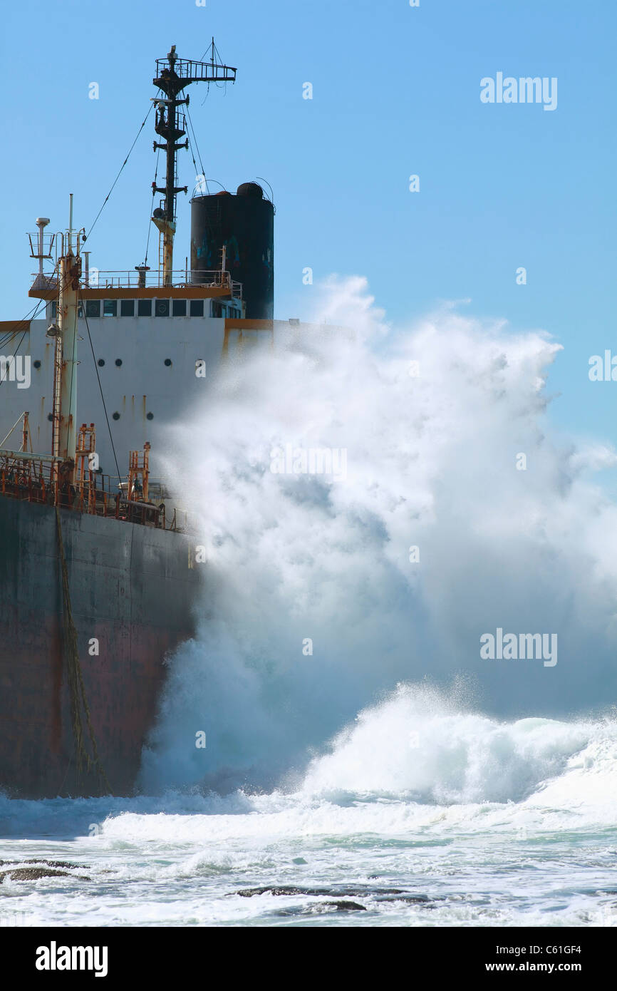 Waves pound the 164 metre bulk tanker, Phoenix, aground on a rocky shelf at Sheffield Beach, KwaZulu Natal, South - Stock Image