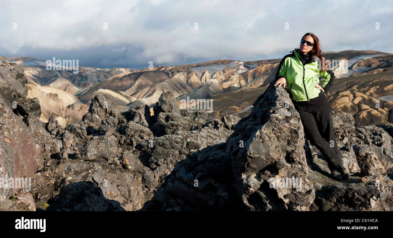 young women tourist posing on the lava field at Landmannalaugar, Iceland - Stock Image