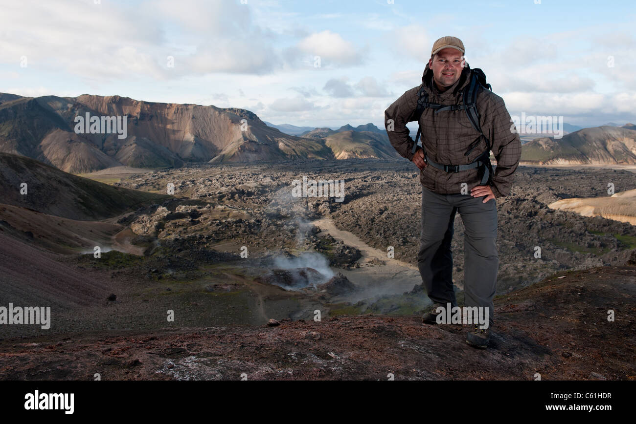 tourist at Landmannalaugar, lava field in the background, Iceland - Stock Image