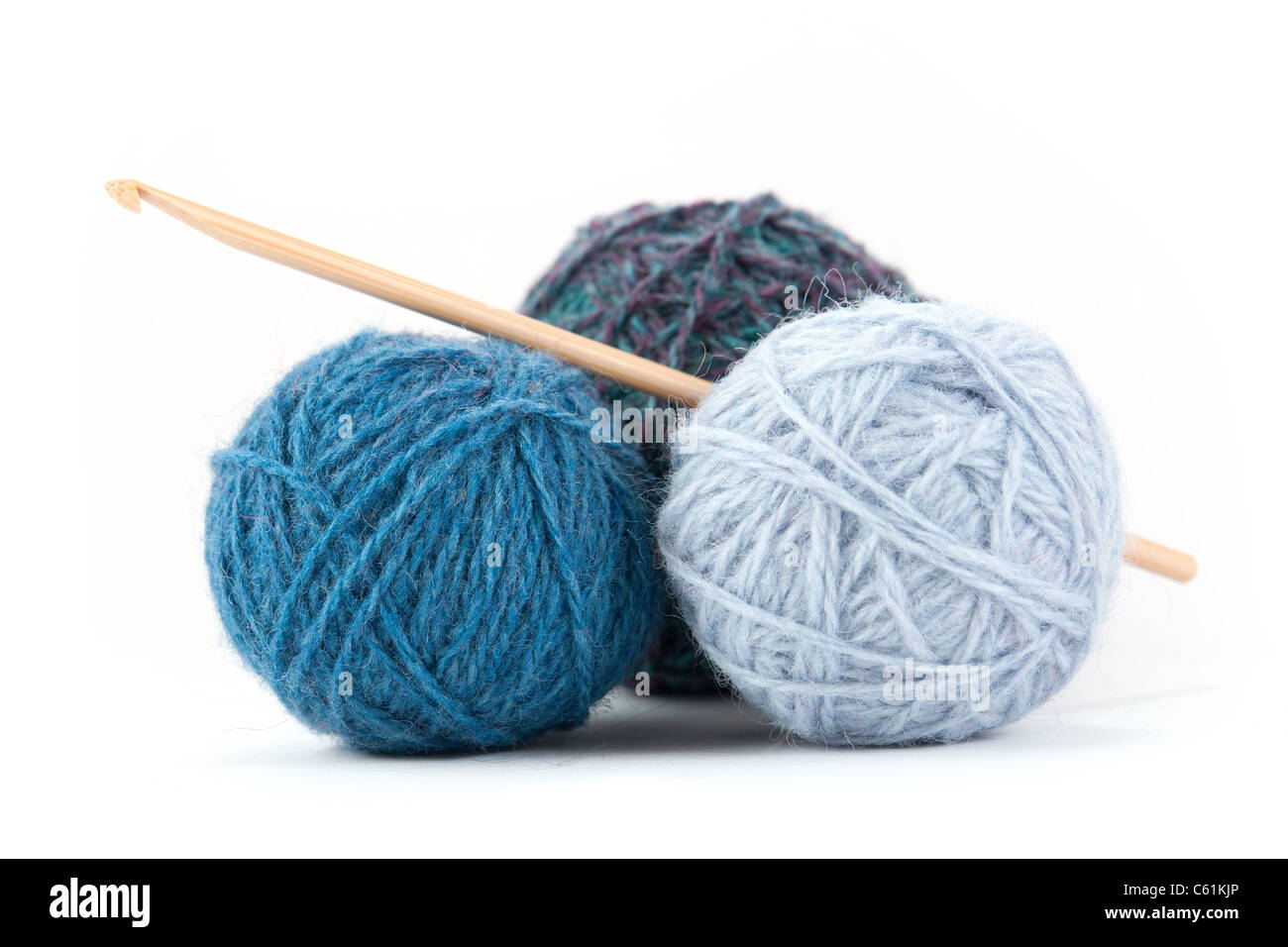 A couple of yarn balls with crochet hook - Stock Image