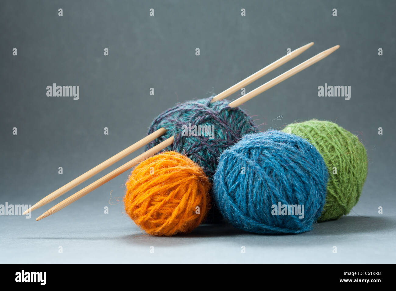 Selection of Yarn Balls with Bamboo Needles - Stock Image