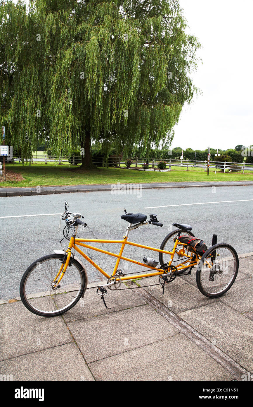 Tandem tricycle on pavement in the UK - Stock Image