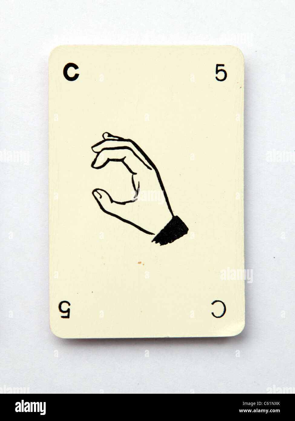 The letter c spelt on an old playing card from the 1960s,  'Kan-U-Go' - Stock Image
