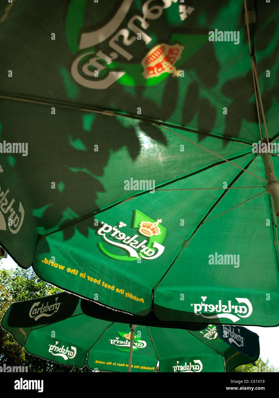 Carlsberg, umbrella int he sun. - Stock Image