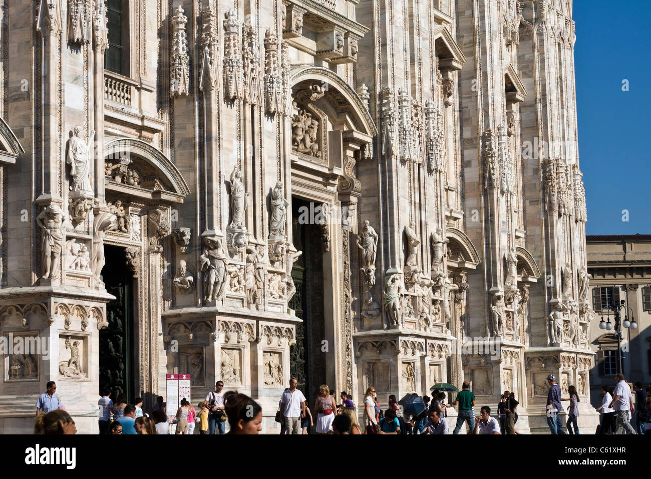 Tourists outside Milan cathedral - Stock Image