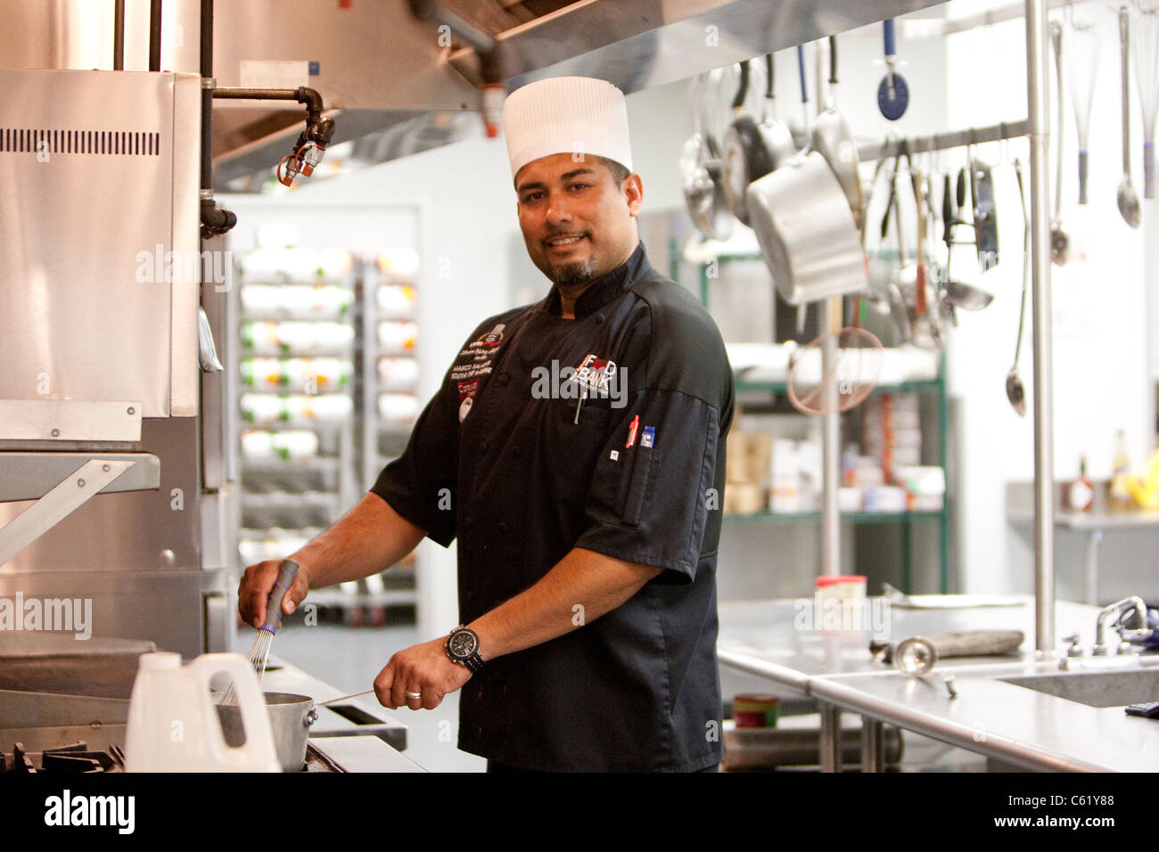 Hispanic male chef works in the kitchen of the san antonio food bank in san antonio texas