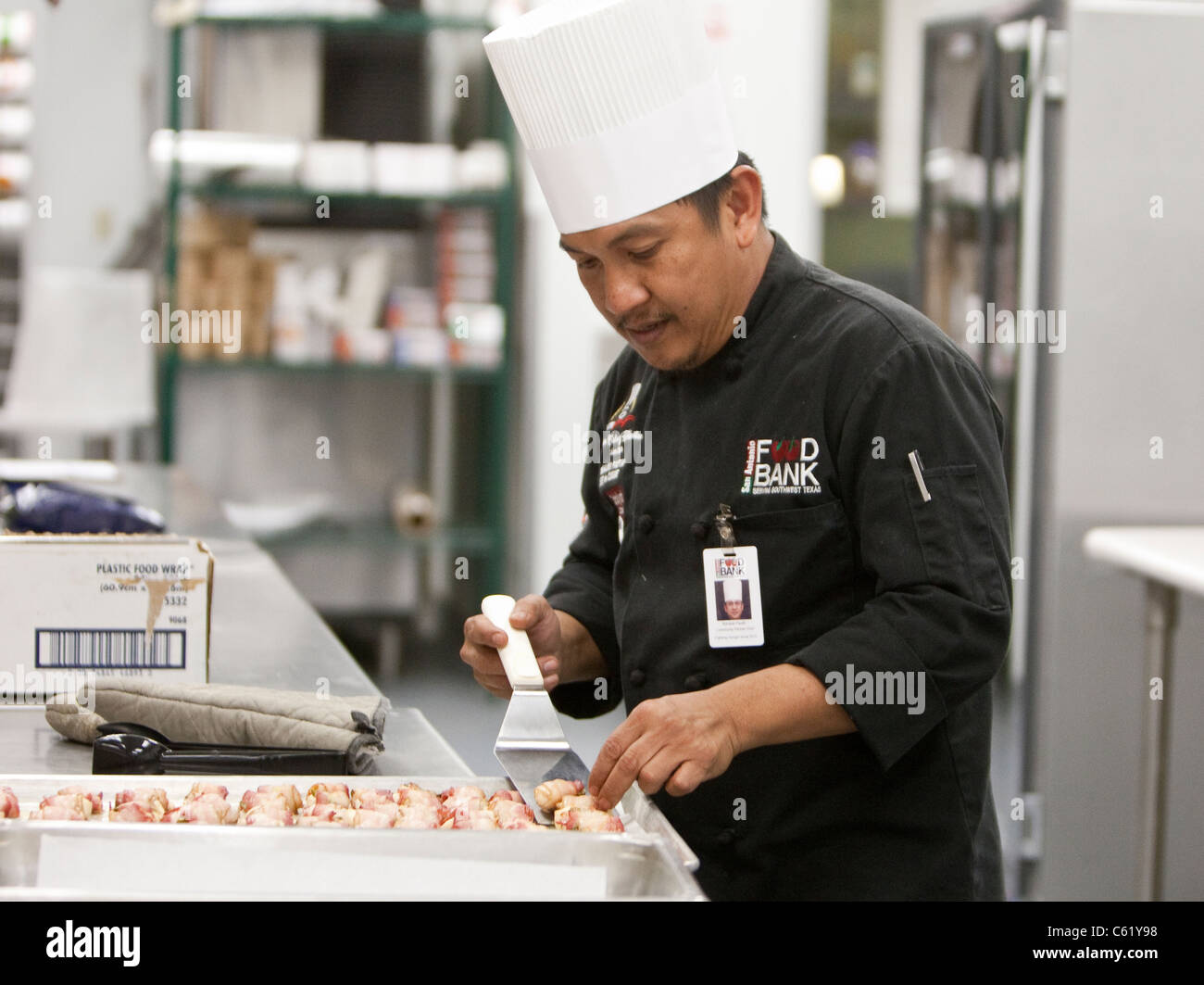 Chefs work in the kitchen of the san antonio food bank in san antonio texas
