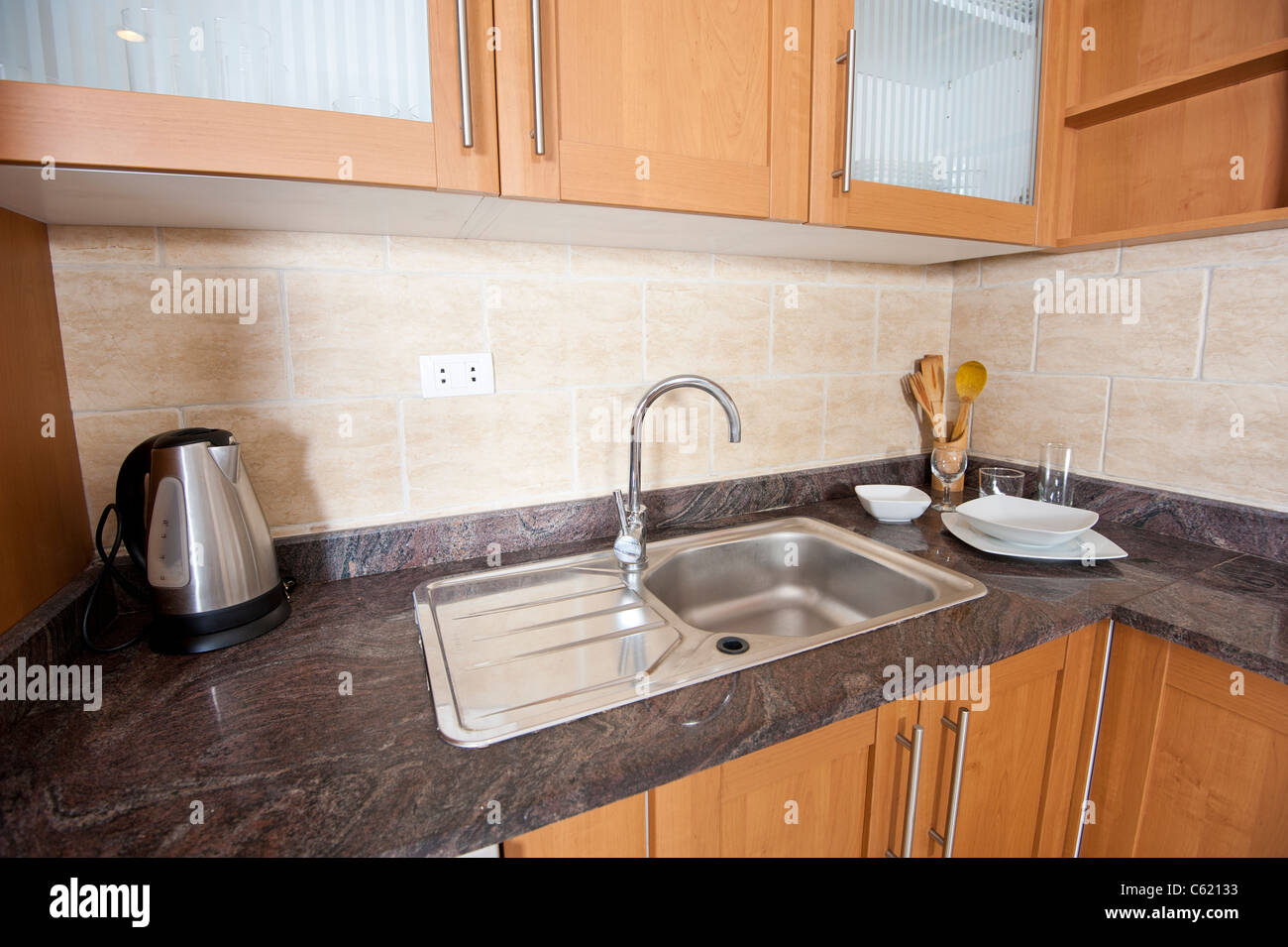 Marble counter top and sink in a modern kitchen - Stock Image