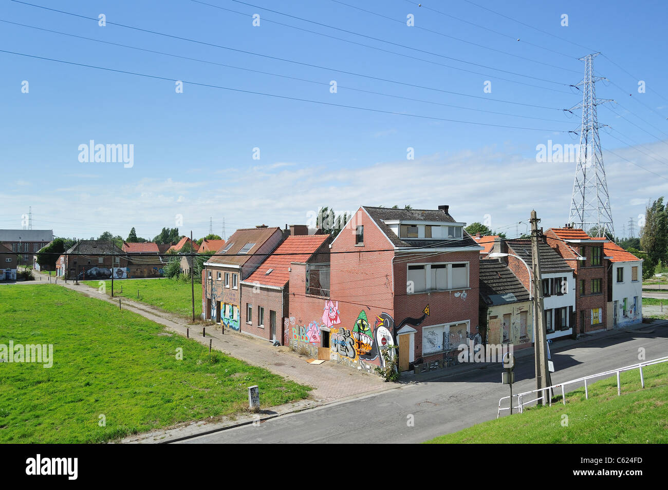 The desolate ghost village Doel along the Antwerp port with abandoned houses occupied by squatters after expropriation, - Stock Image