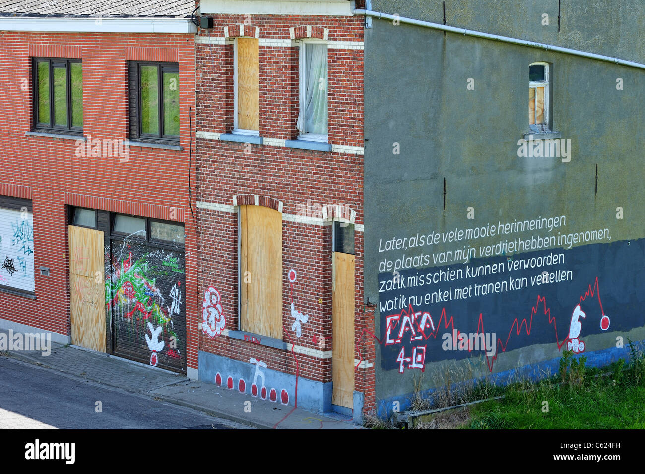The desolate Flemish polder village Doel along the Antwerp port with barricaded houses covered in graffiti by squatters, - Stock Image